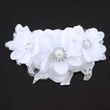 Hårdekoration tre vita blommor
