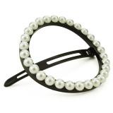 Cirkelspänne med vita pärlor