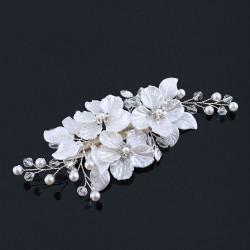Hårsmycke blommor med vita blad